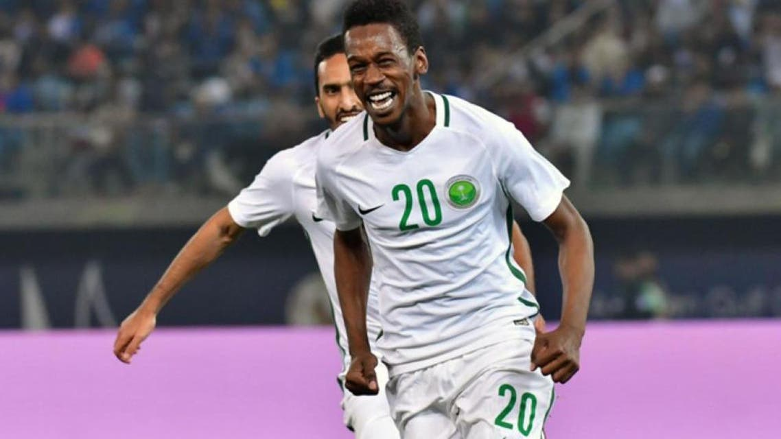 Saudi Arabia's Mukhtar Fallatah celebrates after scoring during the 2017 Gulf Cup of Nations football match between Saudi Arabia and Kuwait at the Sheikh Jaber Al-Ahmad Stadium in Kuwait City on Friday. — AFP