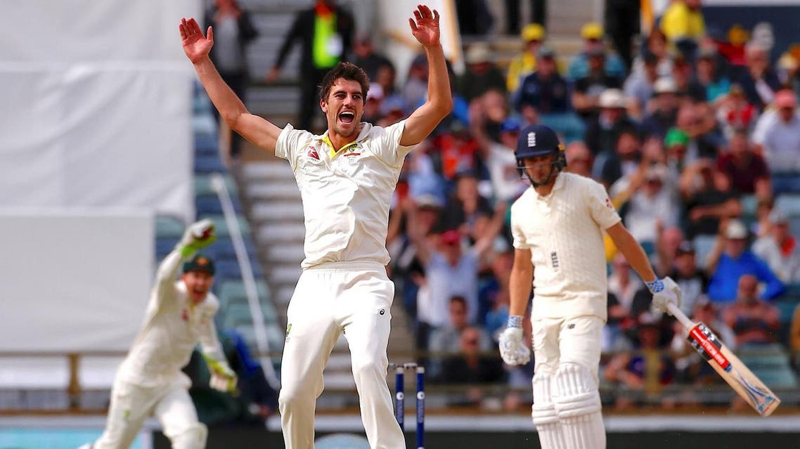 Australia's Pat Cummins celebrates as he takes the wicket of England's Chris Woakes to win the third Ashes cricket test match. (Reuters)