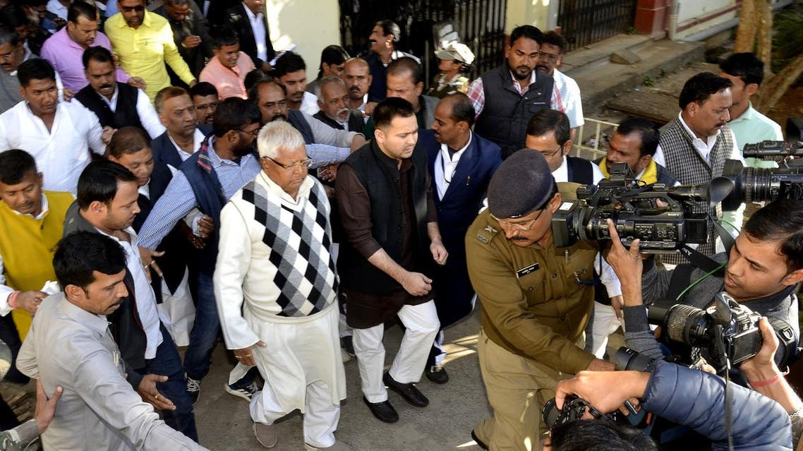 Former Bihar state chief minister Laloo Prasad Yadav, centre left, arrives to appear at a special court in Ranchi, India, Saturday, Dec. 23, 2017. (AP)