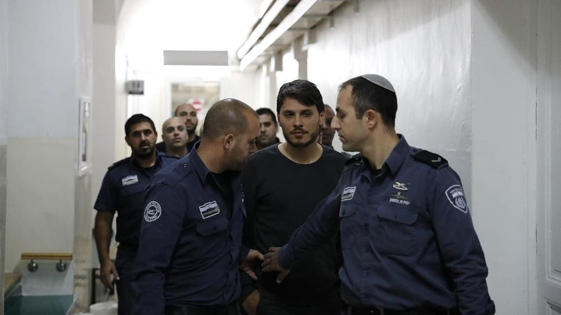 A Turkish tourist (C), who was arrested along with other two earlier in the week at a holy site in Jerusalem following Muslim prayers, is seen at an Israeli court in Jerusalem. (AFP)