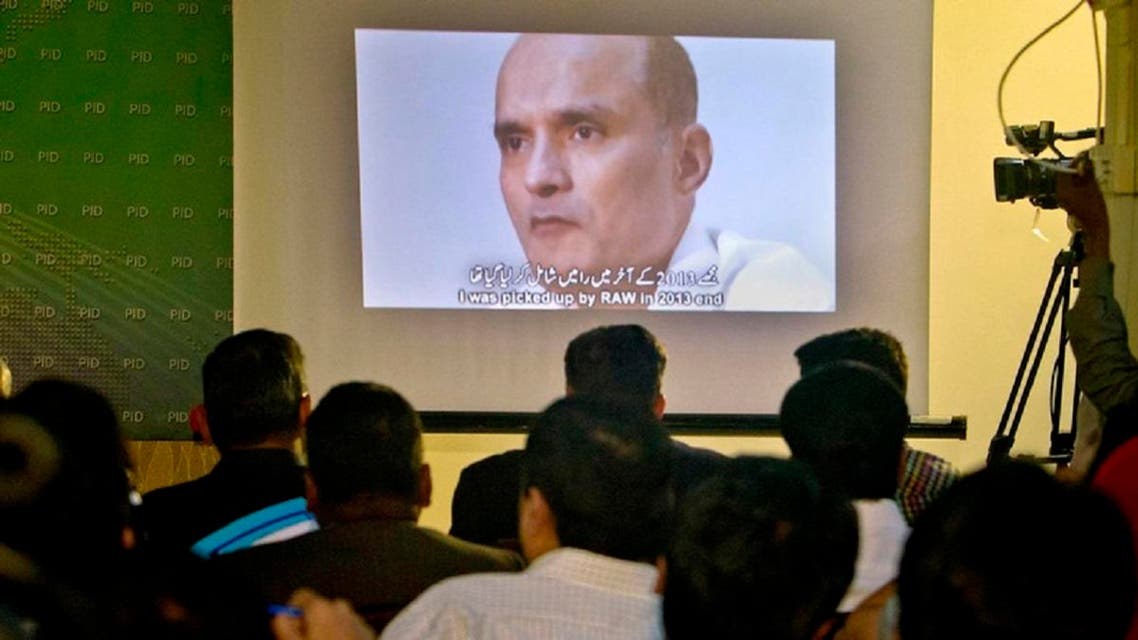An image of Indian naval officer Kulbhushan Jadhav, who was arrested in March 2016, on display during a press conference by Pakistan's army spokesman and the Information Minister, in Islamabad, Pakistan. (AP)