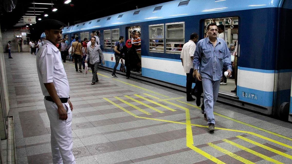 "An Egyptian policeman stands guard at the ""Anwar Sadat"" metro station in the landmark Tahrir Square. (AFP)"