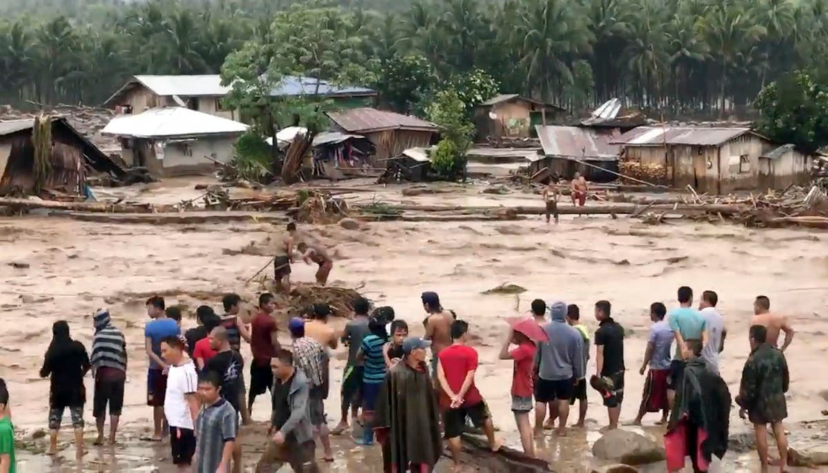 A tropical storm has unleashed flash floods and set off landslides in the southern Philippines leaving dozens of people dead. (AP)