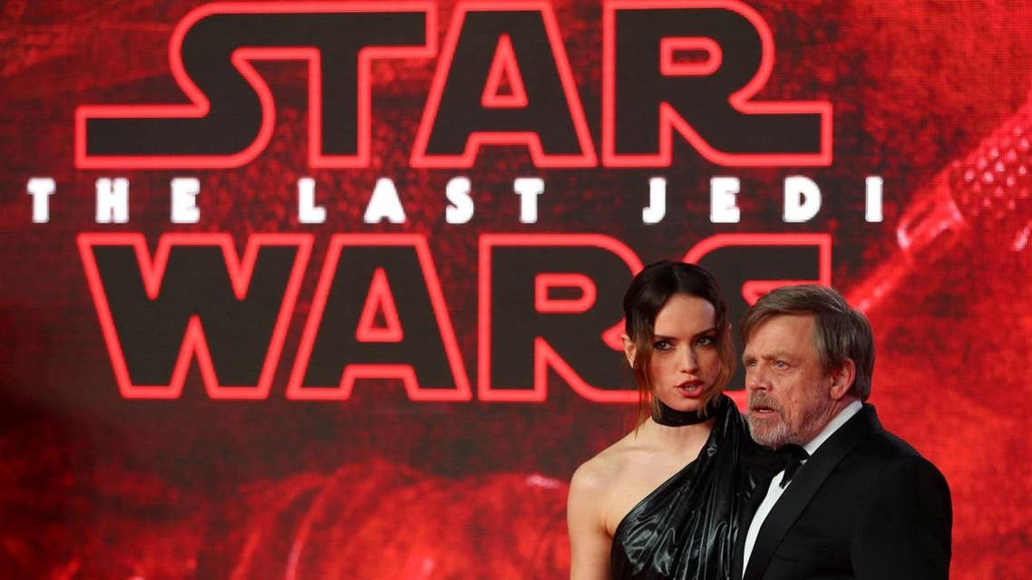 Actors Daisy Ridley and Mark Hamill pose for photographers as they arrive for the European Premiere of 'Star Wars: The Last Jedi', at the Royal Albert Hall in central London. (Reuters)