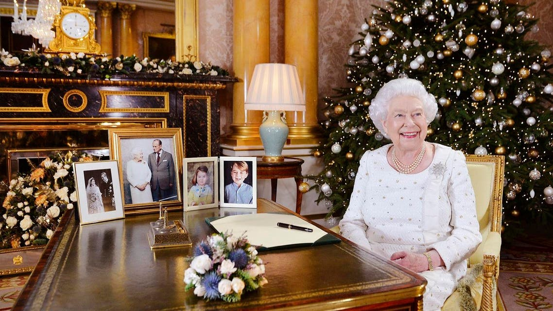 Britain's Queen Elizabeth sits at a desk in the 1844 Room at Buckingham Palace, after recording her Christmas Day broadcast to the Commonwealth, in London. (AP)