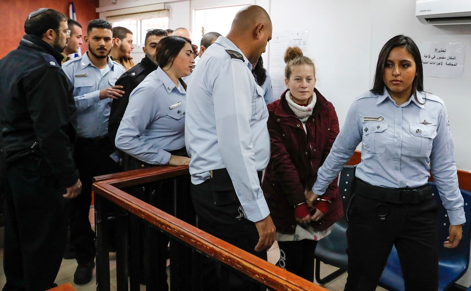 Ahed Tamimi (2nd-R), a prominent 17-year-old Palestinian campaigner against Israel's occupation, appears at a military court. (AFP)