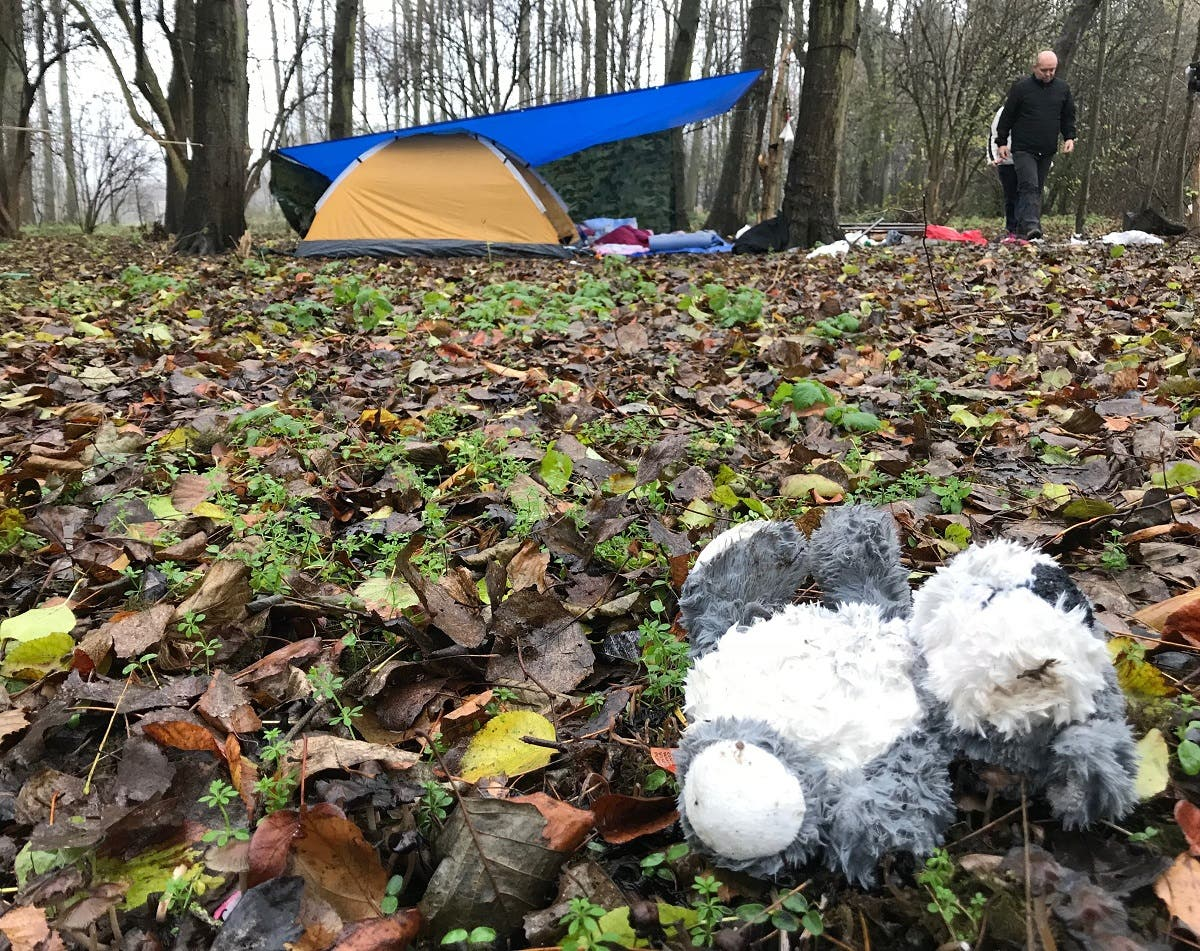 A teddy bear on the ground of the wood in Grande-Synthe abandoned by a child probably when he left the woods with his parents. (Ghassen Fridhi)