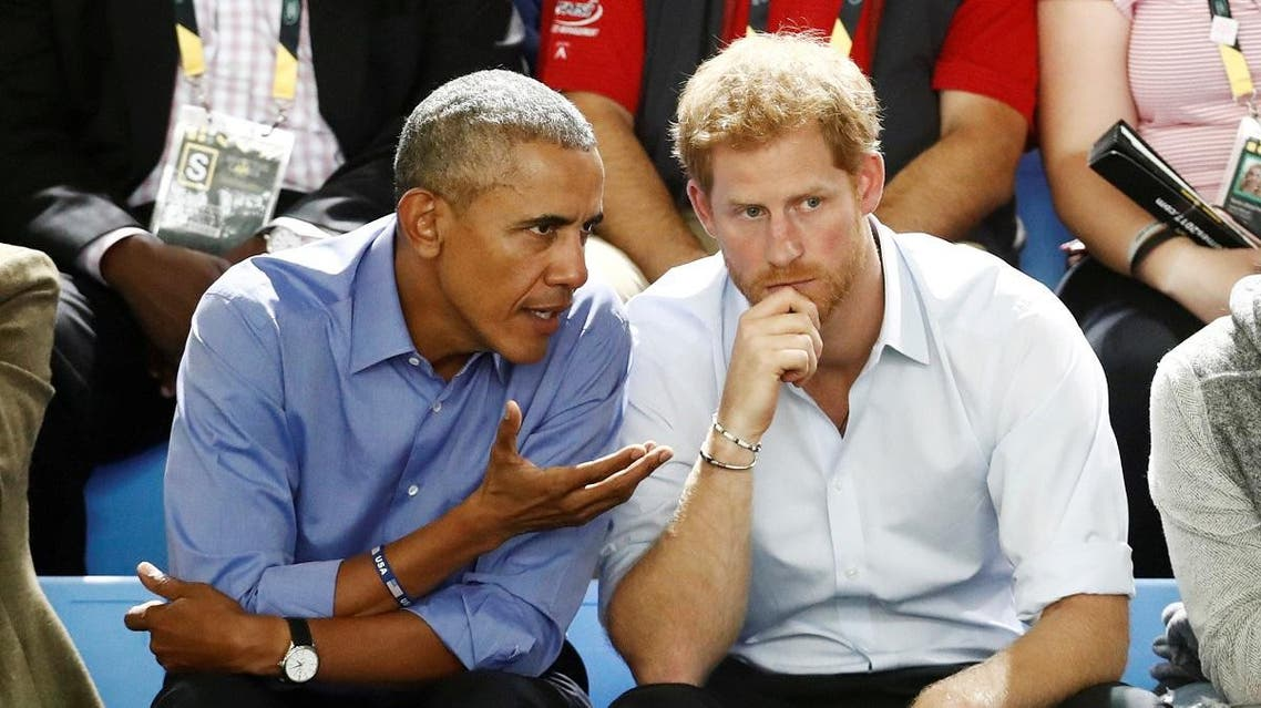 Britain's Prince Harry and former U.S. President Obama watch a wheelchair basketball event during the Invictus Games in Toronto. (Reuters)