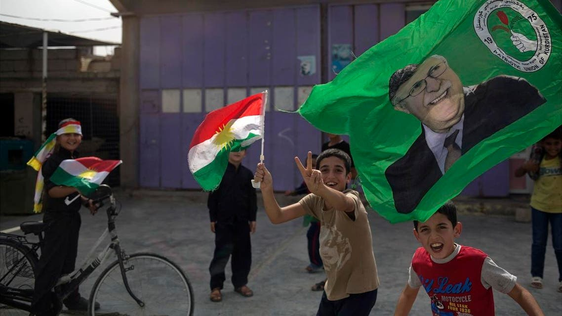 Children holding Kurdish flags run on the streets of the disputed city of Kirkuk. (File photo: AP)
