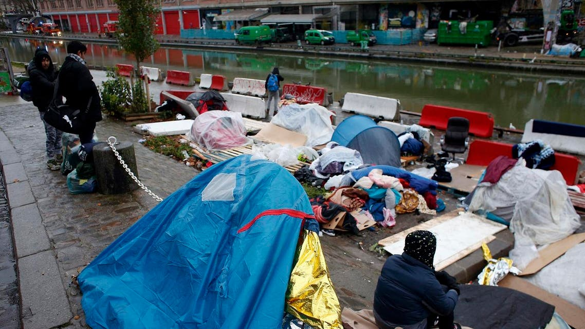 Migrants in a makeshift camp in Paris, Thursday, Dec. 21, 2017. (AP)