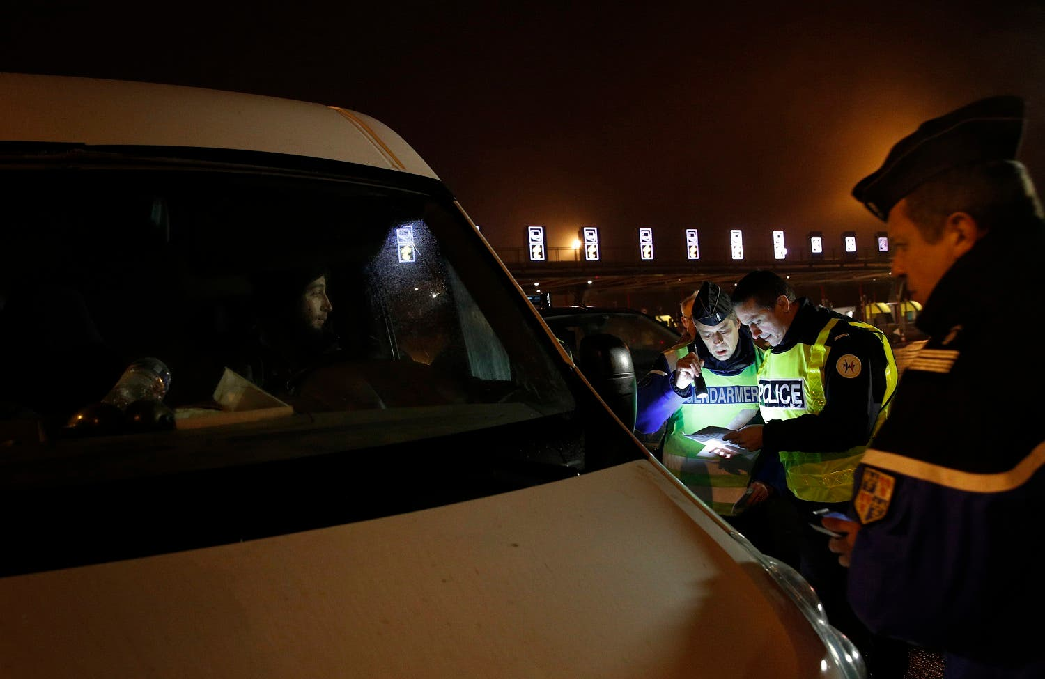 French policemen check a car at the toll booth of Chamant, north of Paris, Thursday, Dec. 21, 2017. (AP)