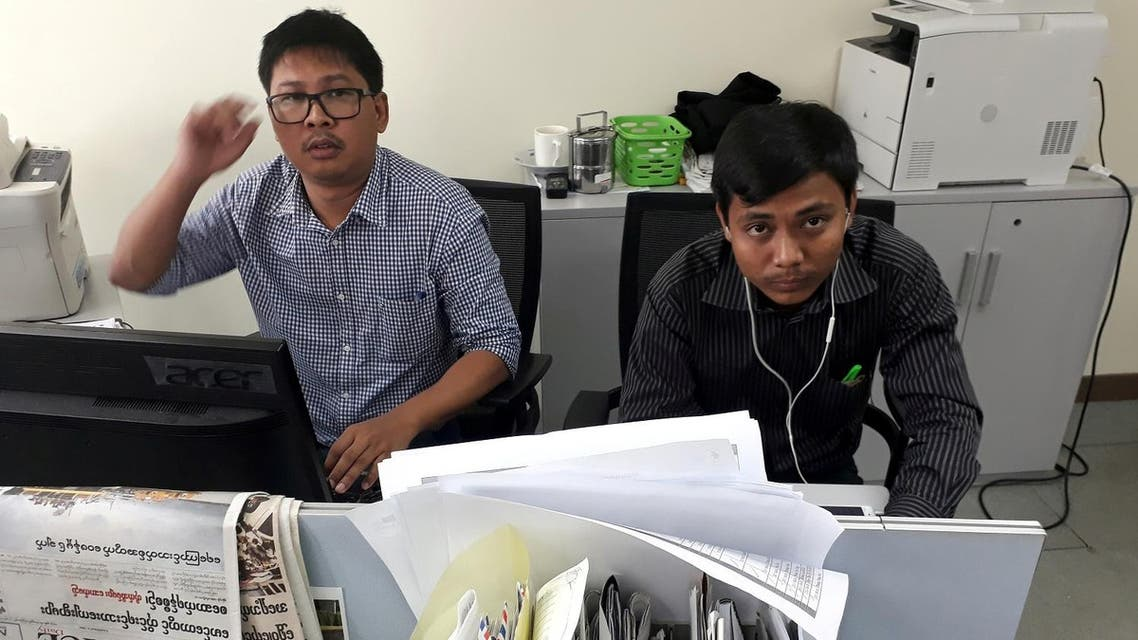 Reuters journalists Wa Lone (L) and Kyaw Soe Oo, who are based in Myanmar, pose for a picture at the Reuters office in Yangon, Myanmar December 11, 2017. (Reuters)