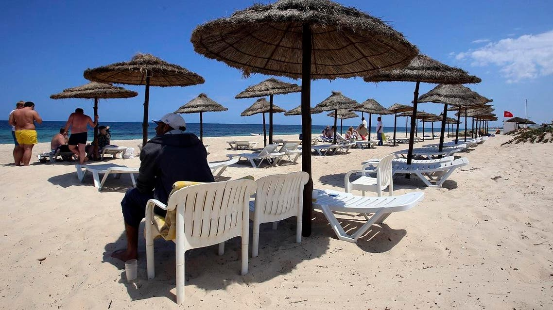 People enjoy the beach of the Tunisian hotel where foreign tourists were massacred in 2015, as it reopens Tuesday May 2, 2017 in Sousse. (AP)
