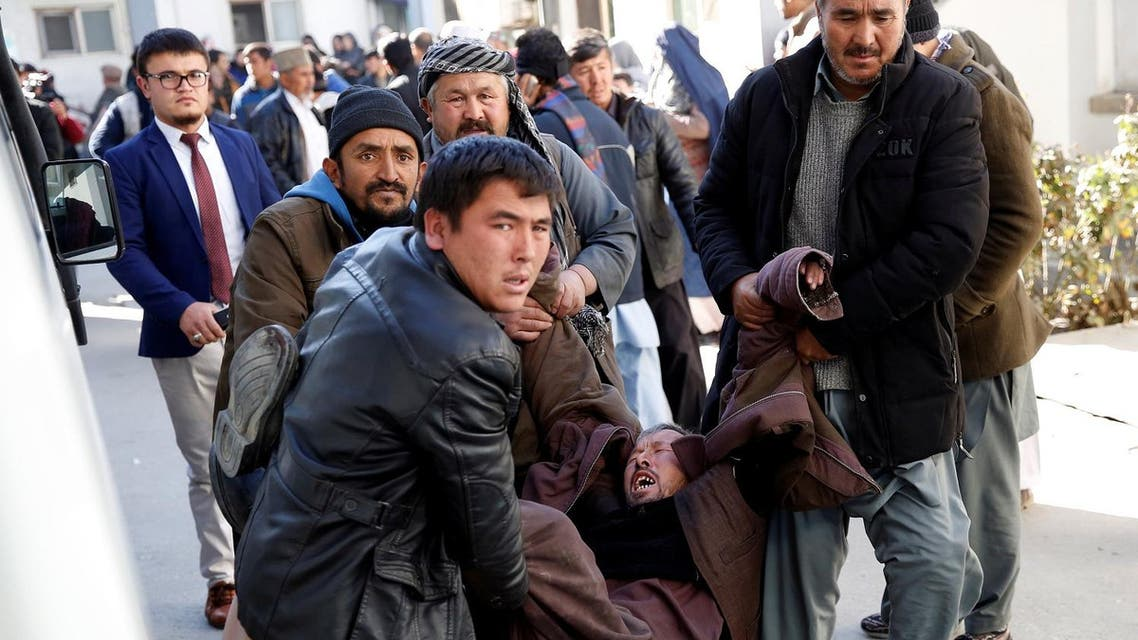 People carry a mourning man at a hospital after a suicide attack in Kabul, Afghanistan December 28, 2017. (Reuters)