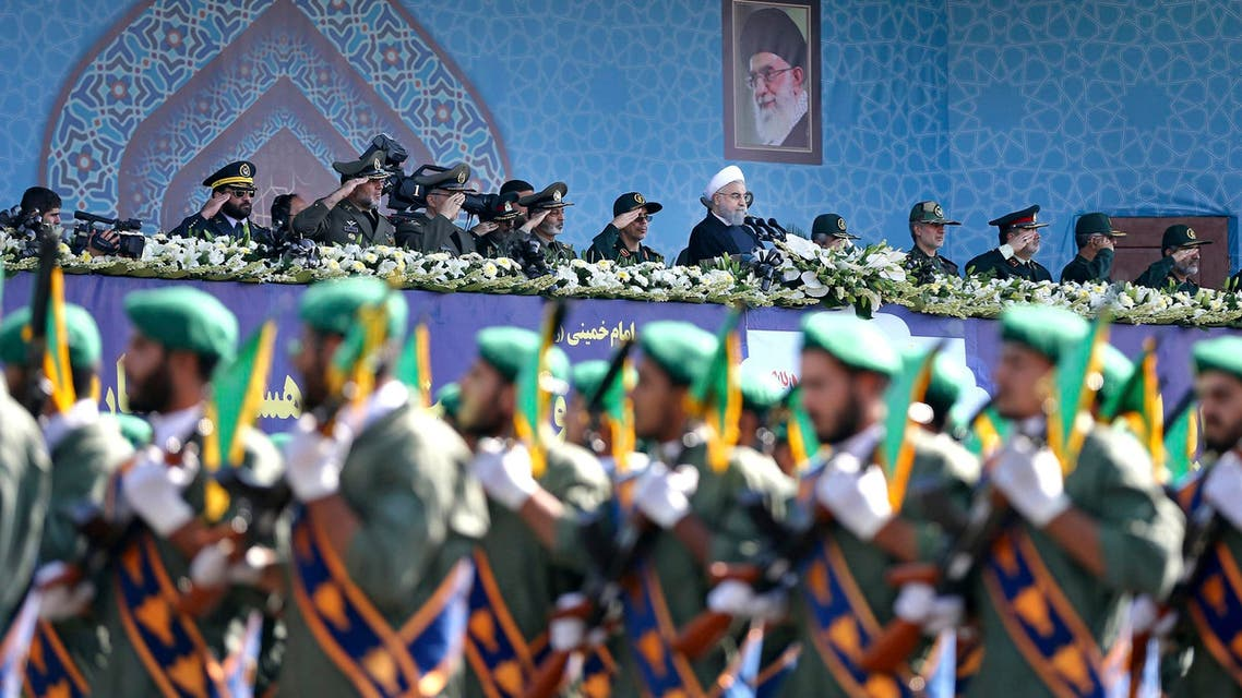 Iran's President Hassan Rouhani reviews army troops marching in front of the shrine of Ayatollah Khomeini, just outside Tehran on Sept. 22, 2017. (AP)