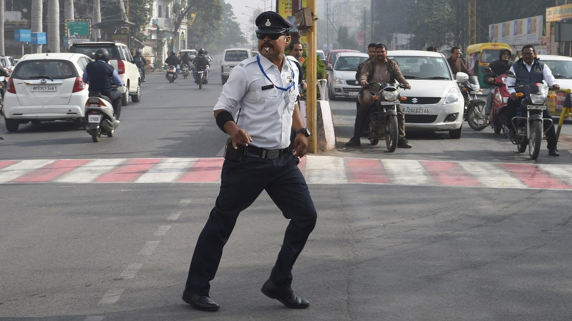 Ranjeet Singh directs traffic while 'moonwalking' at an intersection in Indore on December 22, 2017. (AFP)