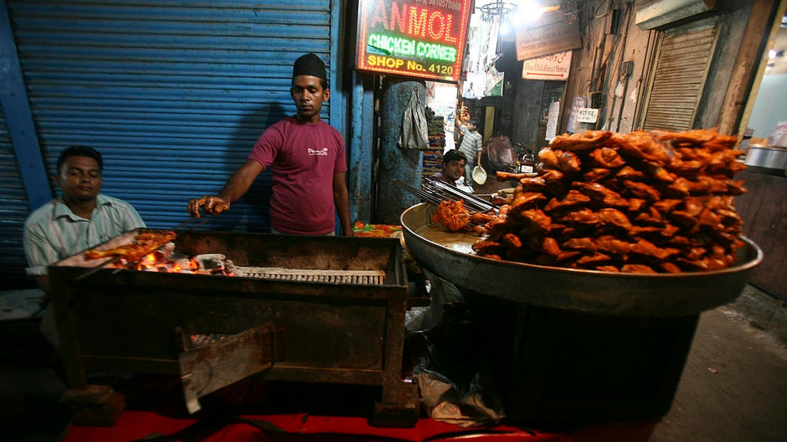 A Muslim shopkeeper sells food on the first day of Ramadan near Jama Masjid in the old quarters of Delhi August 23, 2009. (Reuters)