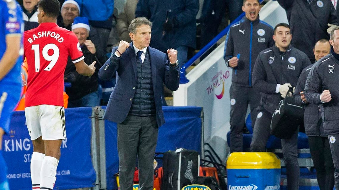 Leicester City's  manager Claude Puel (C) celebrates at the final whistle in the English Premier League football match between Leicester City and Manchester United  in Leicester, on December 23, 2017. The game finished 2-2. (AFP)