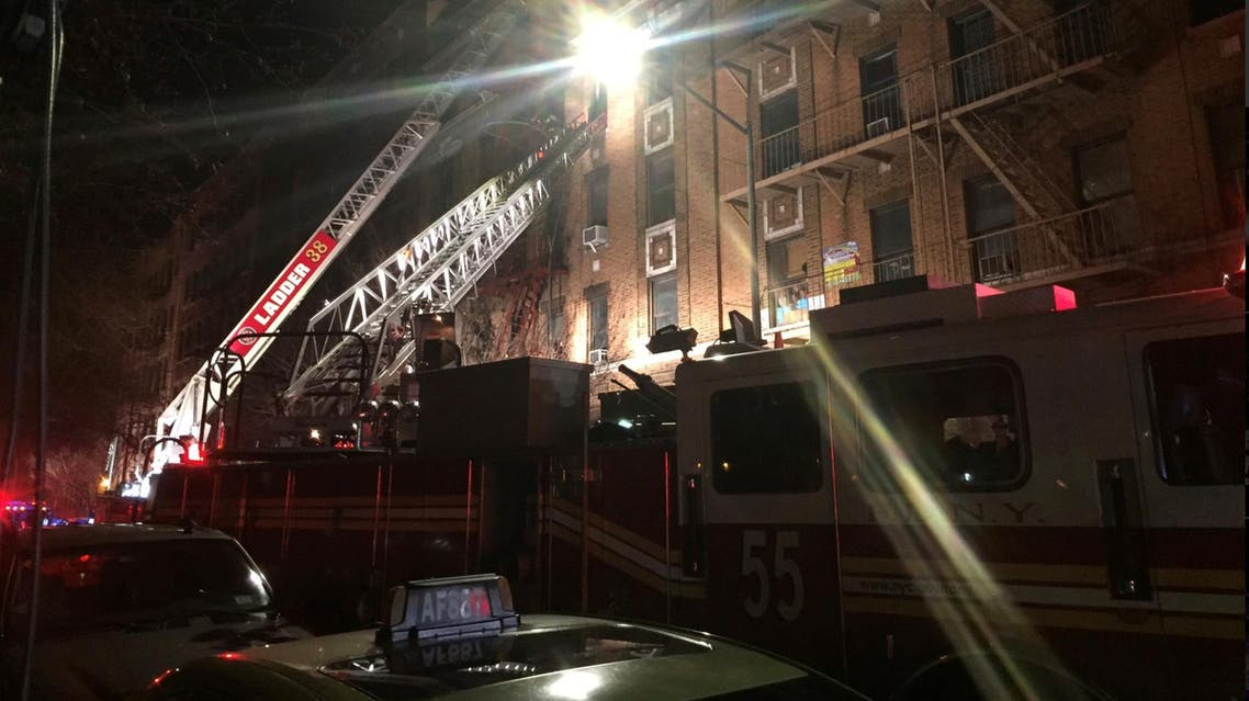 New York Fire Department ladder trucks deploy at a building fire in the Bronx borough of New York on December 28, 2017. (Reuters)