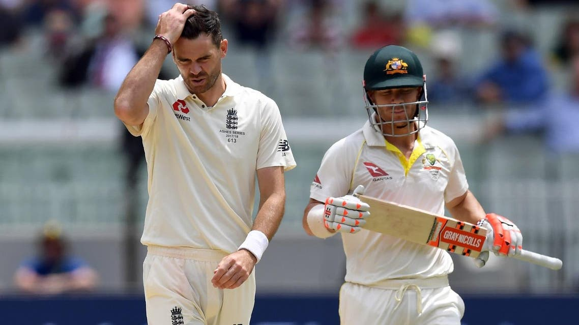 England's paceman James Anderson (left) reacts after bowling a delivery to Australian batsman David Warner (R) on the fourth day of the fourth Ashes cricket Test match at the MCG in Melbourne on December 29, 2017. (AFP)