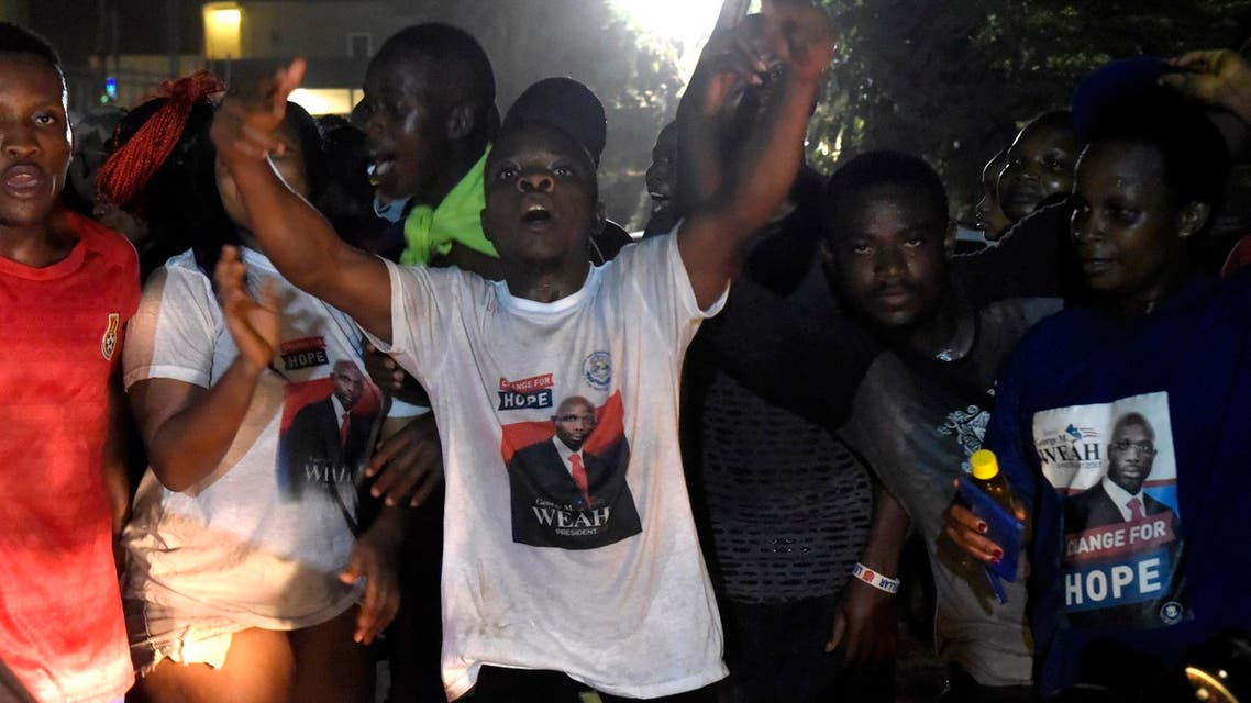 People celebrate the victory of George Weah in Liberia's presidential run-off, on December 28, 2017 in Monrovia. (AFP)