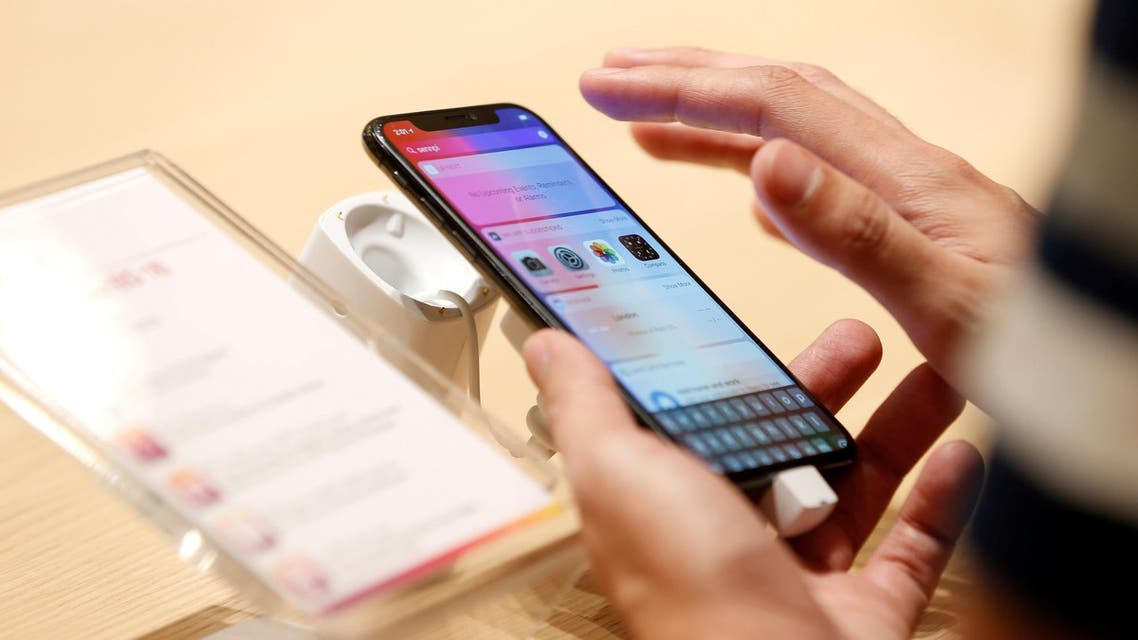 A customer tests the features of the newly launched iPhone X at VIVA telecommunication store in Manama, Bahrain, on November 3, 2017. (Reuters)