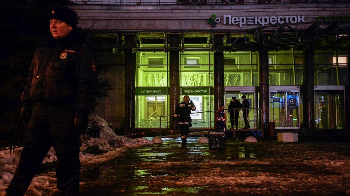 Firefighters and police officers work at the site of a blast in a supermarket in Saint Petersburg on December 27, 2017. (AFP)