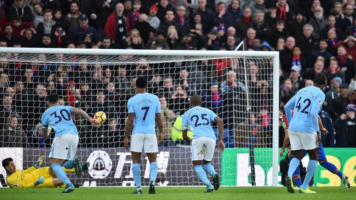 Crystal Palace's midfielder Luka Milivojevic (R) sees his penalty saved by Manchester City's goalkeeper Ederson (L) during the English Premier League match on December 31, 2017. (AFP)