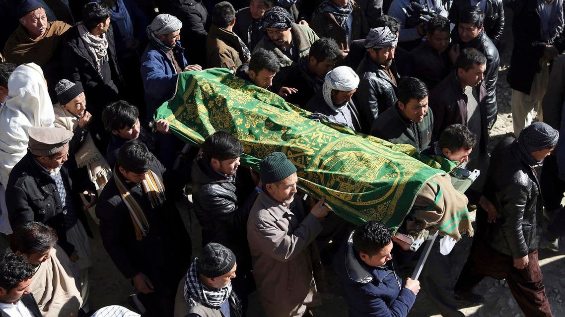 People carry the coffin of a relative who died in Thursday's suicide attack on a Shiite cultural center in Kabul, Afghanistan, on Friday, Dec. 29, 2017. (AP)