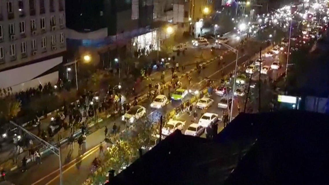 An image grab taken from a handout video released by Iran's Mehr News agency reportedly shows a group of men walking down a street in Tehran on December 30, 2017. (AFP)