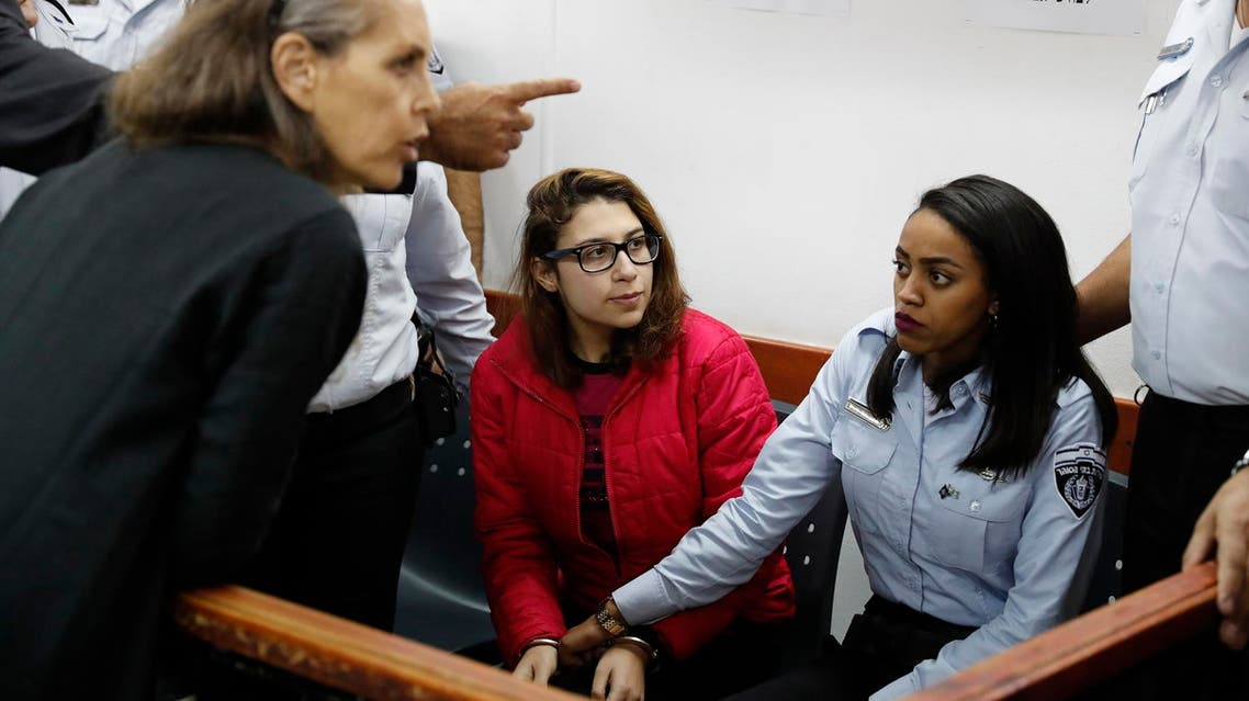 Nour Tamimi (C) in a military court at the Israeli-run Ofer prison in the West Bank village of Betunia on December 28, 2017. (AFP)
