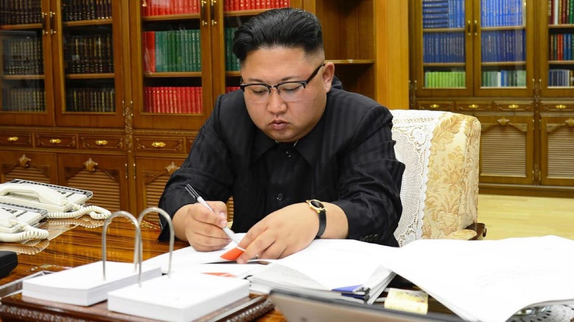 North Korean leader Kim Jong-Un signing the order to carry out the test-fire of the intercontinental ballistic missile Hwasong-14 at an undisclosed location. (AFP/KCNA VIA KNS)