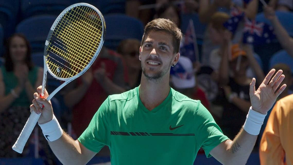 Thanasi Kokkinakis of Australia celebrates his victory over Vasek Pospisil of Canada in their third session men's singles match on day two of the Hopman Cup. (AFP)