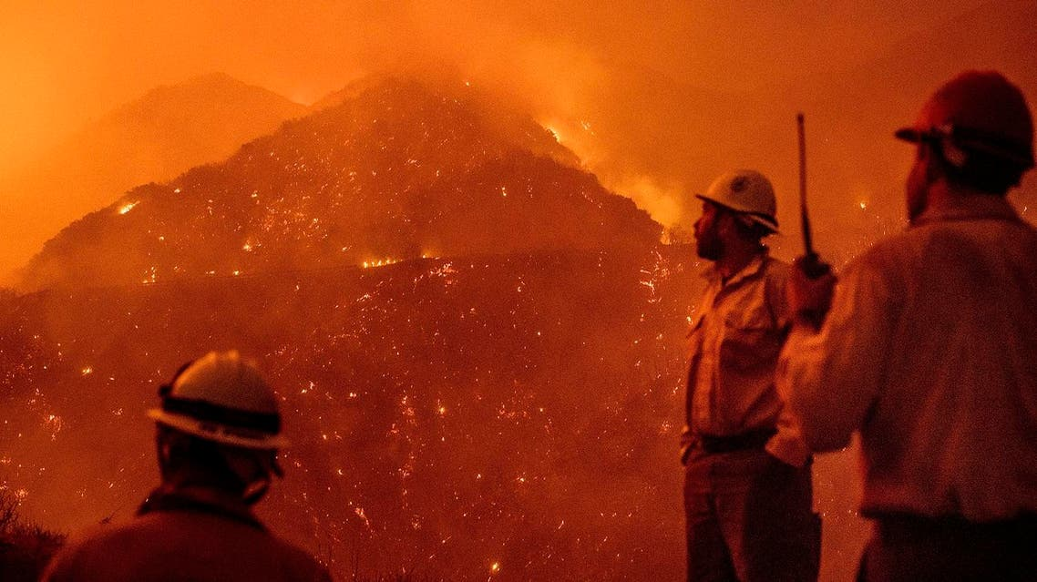 firefighters monitor the Thomas fire as it burns through Los Padres National Forest near Ojai, Calif. (AP)