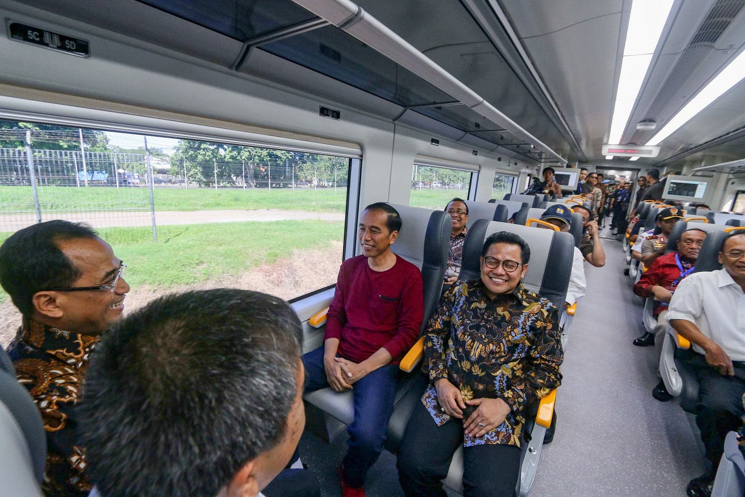 Indonesia's President Joko Widodo (3rd L) sits in the newly launched airport train along the train line linking Soekarno-Hatta International Airport to the city centre in Tangerang, on the outskirts of Jakarta, on January 2, 2018. Jakarta launched the first train connecting its international airport to the city centre on January 2 as the sprawling Indonesian capital moves to tackle the gridlock that can make the trip an hours-long headache. (AFP)