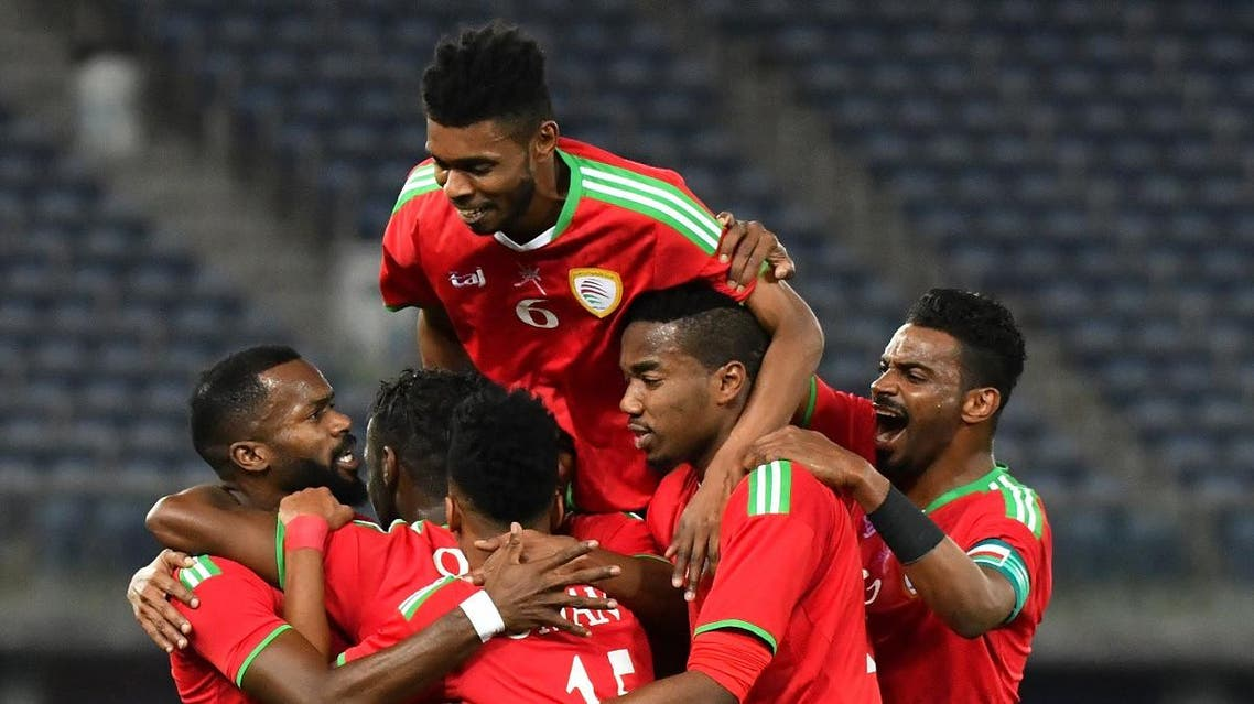Oman's players celebrate after scoring a goal during the 2017 Gulf Cup of Nations semi-final football match between Oman and Bahrain. (AFP)