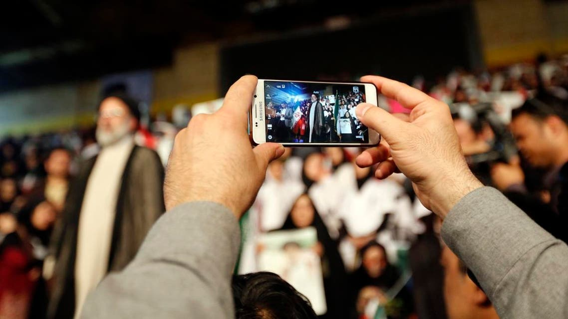 A supporter of Ebrahim Raisi takes a picture of the Iranian presidential candidate during a campaign rally in the capital Tehran on April 29, 2017. (AFP)