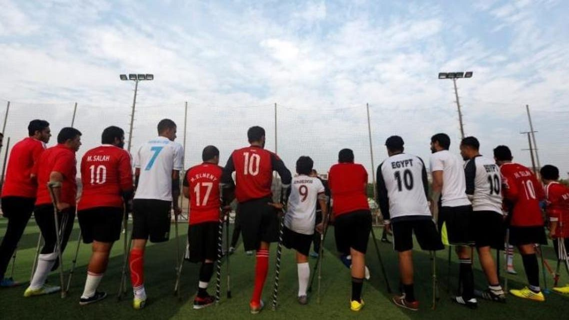 """Members of """"Miracle Team"""", a soccer team made up of one-legged, crutch-bearing soccer players, listen to their coach before a training session at El Salam club on the outskirts of Cairo, Egypt December 29, 2017. (Reuters)"""