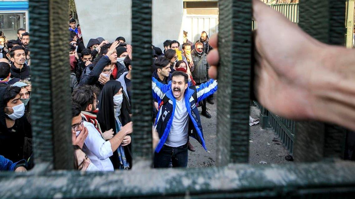 University students attend an anti-government protest inside Tehran University, in Tehran, Iran. (AP)
