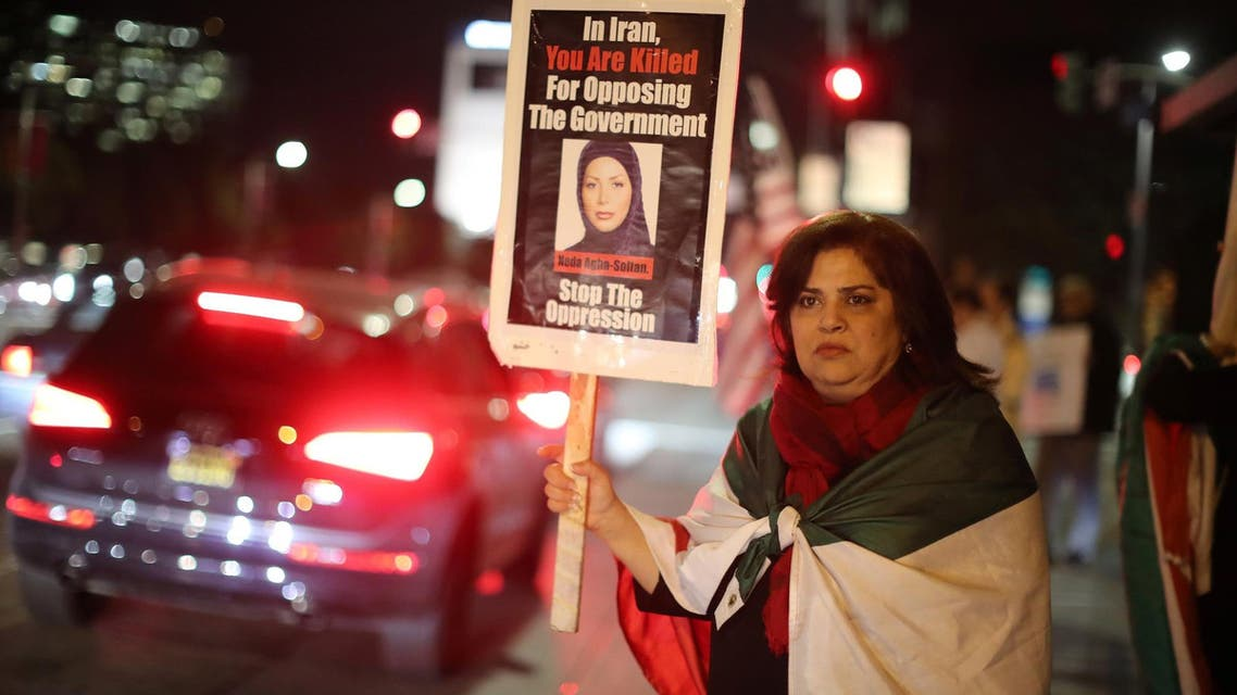 Iranian expatriate Roxanne Ganji holds a sign at a protest in Los Angeles on January 3, 2018. (Reuters)