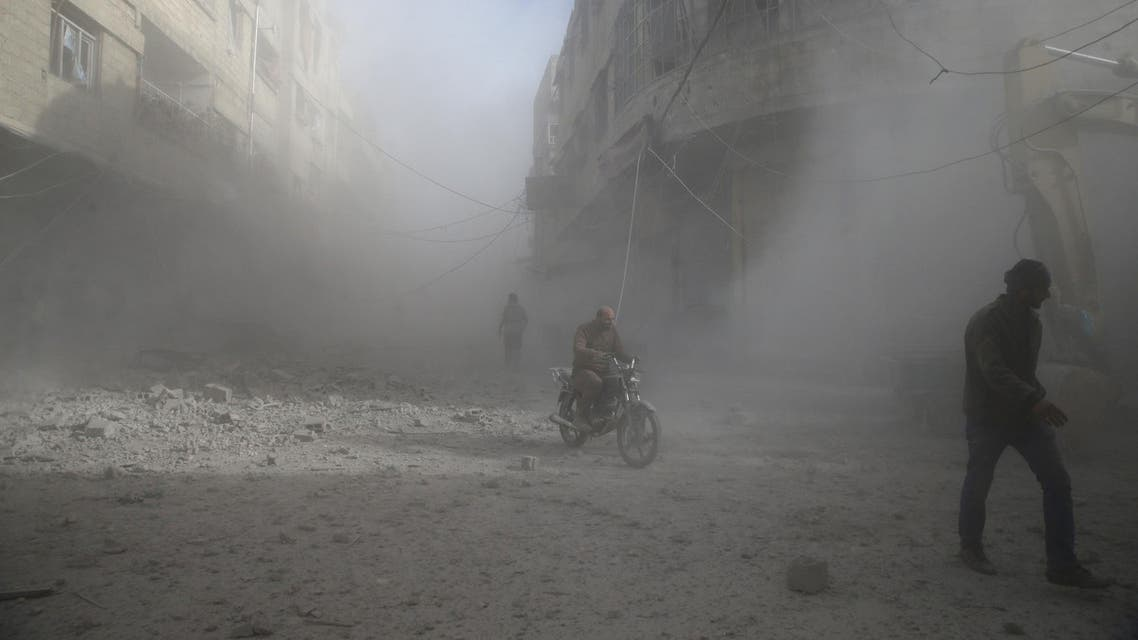 People are seen during shelling in the town of Hamoria, eastern Ghouta in Damascus, on December 3, 2017. (Reuters)