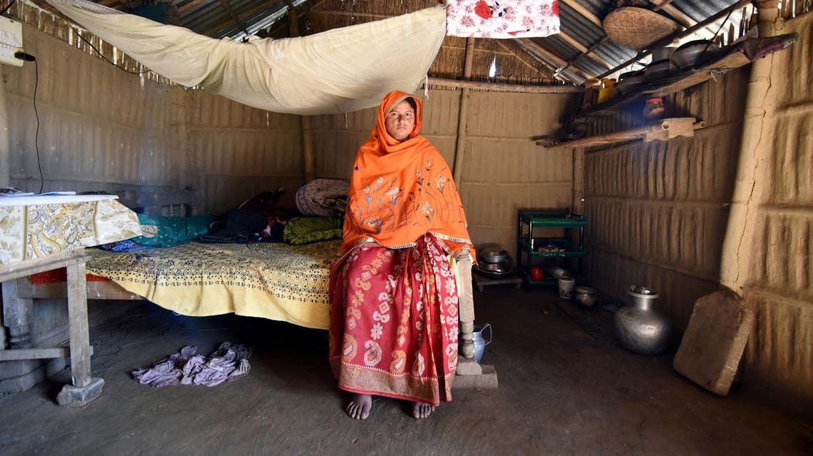 Marzina Bibi inside her house in Fofonga village in Goalpara district in the state of Assam on January 2, 2018. (Reuters)