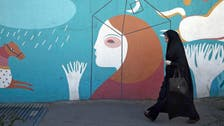 Iranian who removed headscarf sentenced to one year in prison