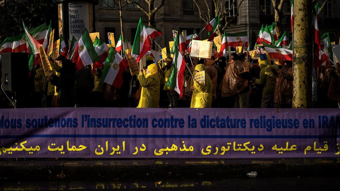 Protesters hold flags in support of the Iranian people amid a wave of protests spreading throughout Iran, on January 3, 2018, in Paris. (AFP)