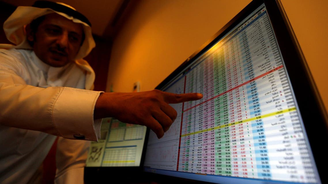 An investor gestures as he monitors a screen displaying stock information in Riyadh on November 6, 2017. (Reuters)