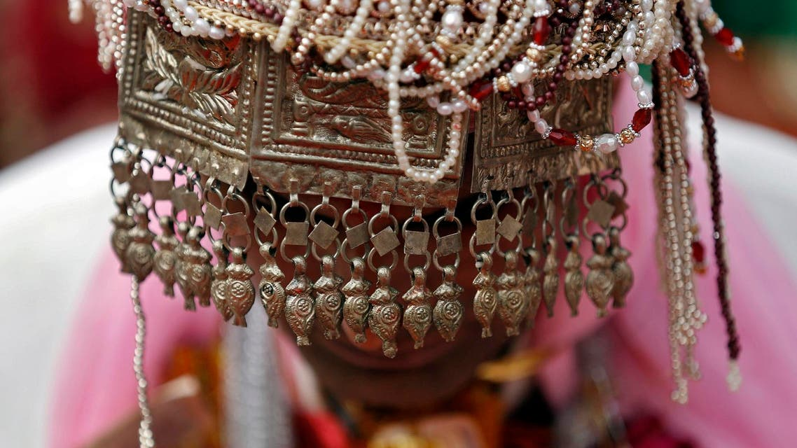 A groom wearing headgear attends a mass wedding ceremony in the old quarters of Delhi February 20, 2015. (Reuters)