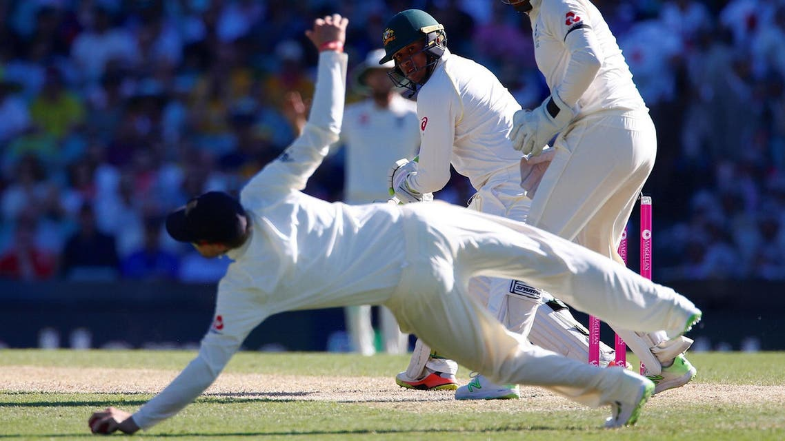 Australia's Usman Khawaja watches England's captain Joe Root dive to stop the ball during the second day of the fifth Ashes cricket test match. (Reuters)