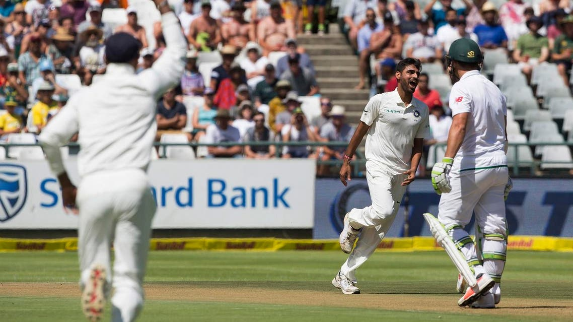 Indian fast bowler Bhuvneshwar Kumar takes the wicket of Dean Elgar of South Africa in the first over on the first day of their first day test between South Africa and India in Cape Town, South Africa, on Jan 5, 2018. (AP)