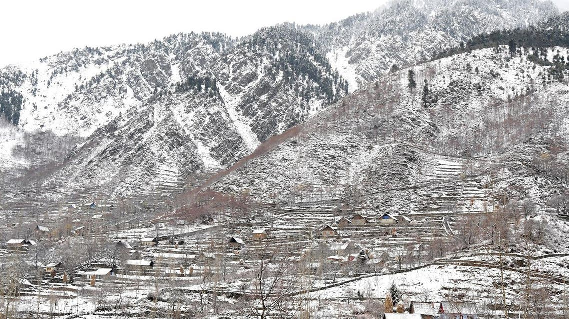 General view of snow covered houses after a snowfall on the outskirts of Srinagar on December 13, 2017. (AFP)