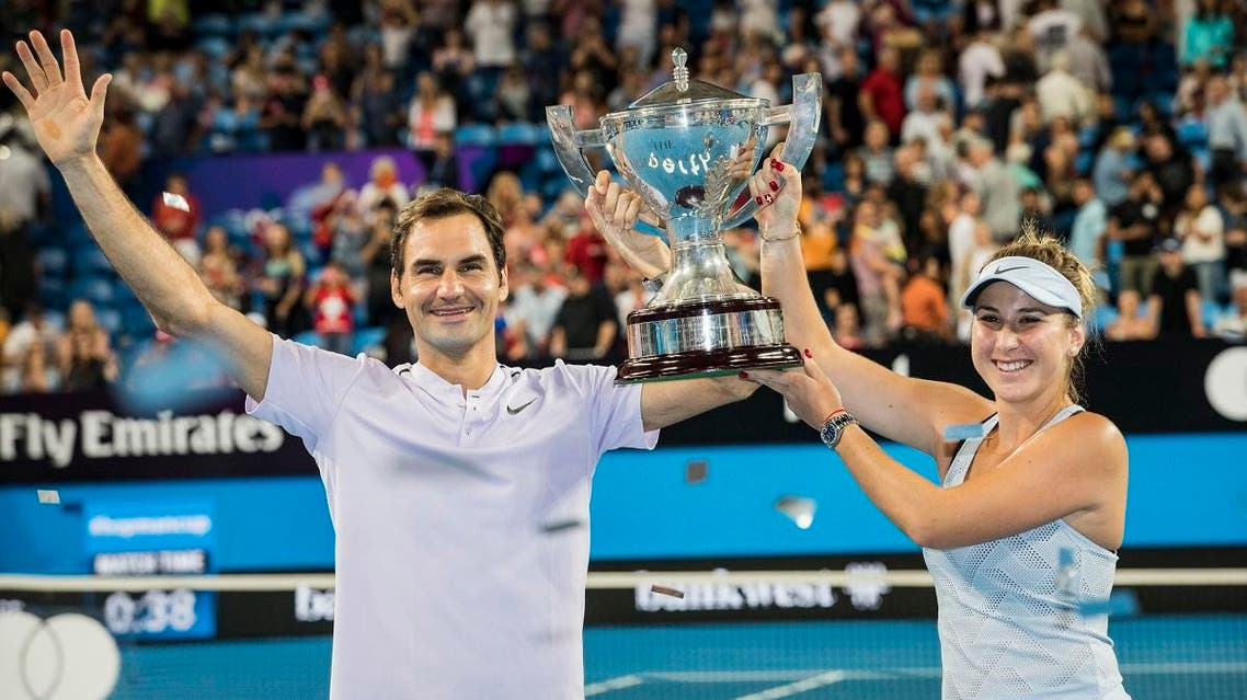 Roger Federer and Belinda Bencic of Switzerland celebrate winning the final at the Hopman Cup tennis tournament in Perth. (AP)